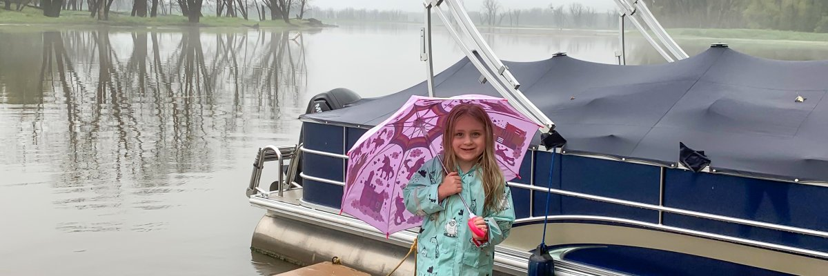 Bea standing on the dock in the rain