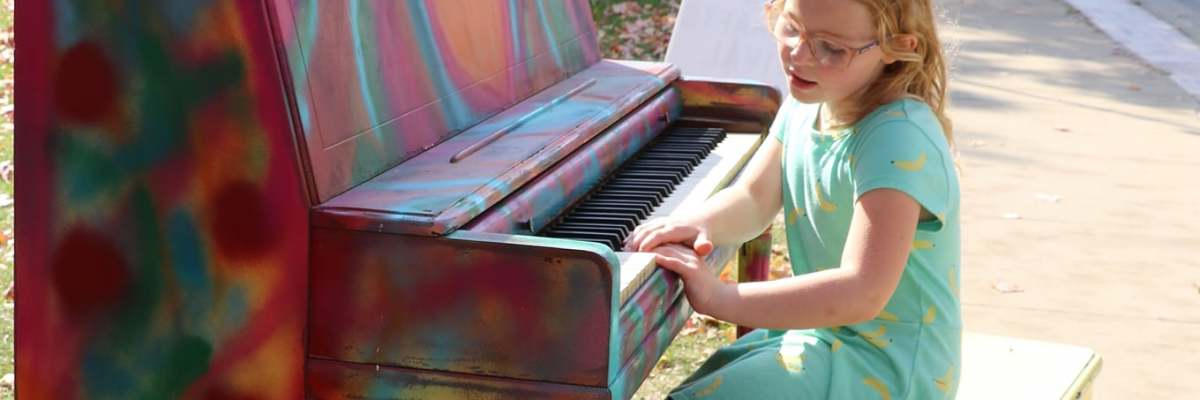 Charlotte playing the piano at the Arts and Crafts Festival in McGregor, IA